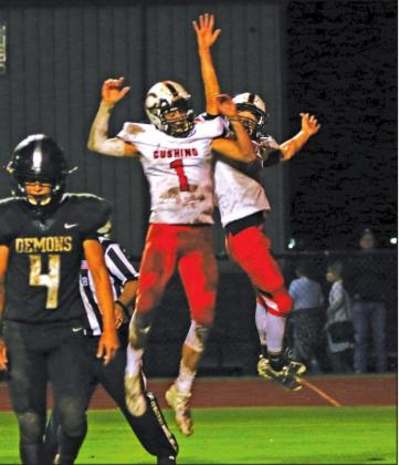 Blaze Berlowitz and Austin Munday celebrate a TD pass during the Tigers 27-7 victory over country rival Perkins-Tryon Friday. Berlowitz threw for 340 yards.