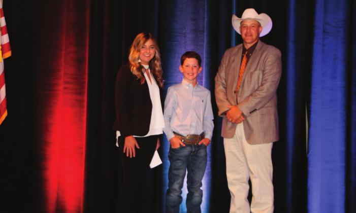 Outgoing OJCA President, Sarah Armitage (left) and Mike Weeks, OCA President (right) pictured with Kelton Arthur, 2020 OJCA All-Around Junior Cattleman of the Year.
